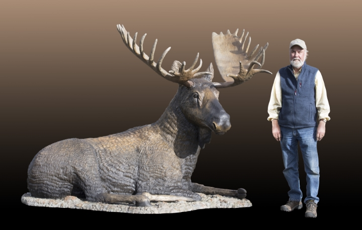 Gravel Bar Rest Stop life-size moose sculpture with Bud Burger standing beside it